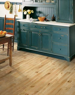 rustic teal cabinets - wood table and chair - hardwood kitchen flooring