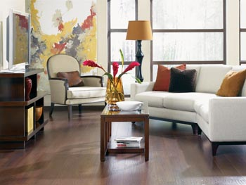 living room with laminate wood flooring - white sofa with pillows - coffee table