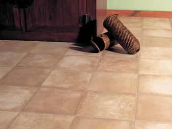 brown pair of boots - tan luxury vinyl flooring